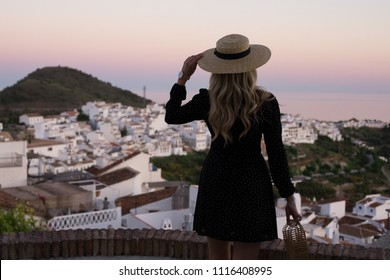 Stylish travel blogger sightseeing in Málaga,  south of Spain.