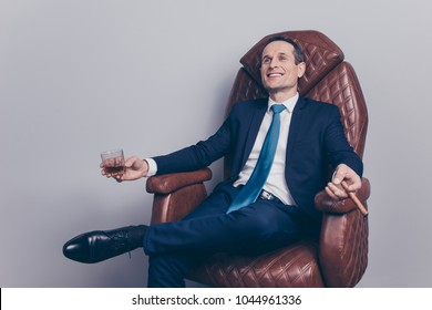 Stylish trend comfort careless we-off posh stock banker shares finance money success leader concept. Cheerful excited proud mature handsome confident excited head on company relaxing ion leather chair