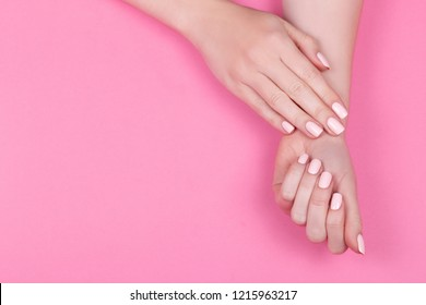 Stylish trendy female pink manicure.