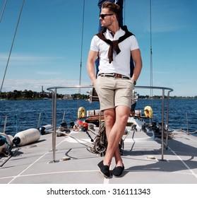 Stylish trendy man on a regatta