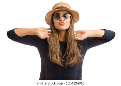 Stylish and trendy woman puckering lips and wearing sunglasses on white background