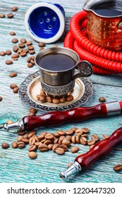 Stylish Turkish hookah for two mouthpieces and a cup of coffee.Arabian shisha and coffee
