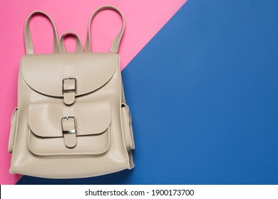 Stylish urban backpack on color background, top view. Space for text