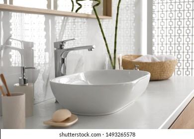 Stylish vessel sink under mirror in bathroom. Interior element