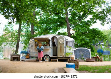 Stylish vintage mobile bar in a green park. Hipster cafe in the city park. Prague / Czechia - 05.21.2019