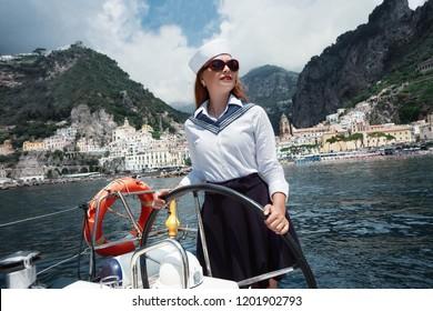 Stylish wealthy woman on a luxury white regatta.