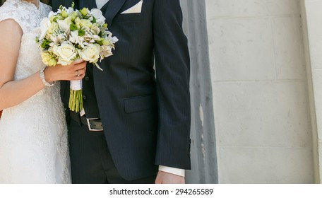 Stylish wedding couple. Groom and bride together.
