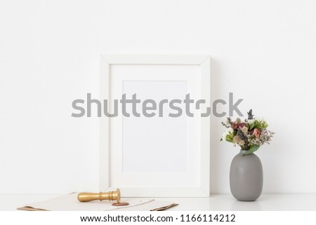 1c6223115b5b Stylish white a5 portrait frame mockup with cute bouquet of dried flowers  in vase and gold