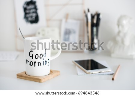 Stylish white desktop, home office interior details with coffee