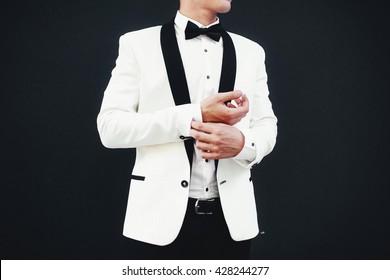 Stylish white jacket with the black collar