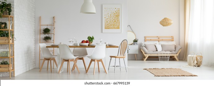 Stylish white studio apartment with dining room and living room
