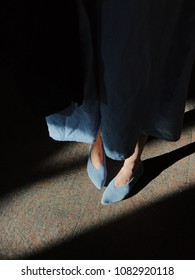 Stylish woman blue outfit- dress and shoes in light and shadow. Street  fashion