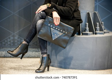 Stylish woman with clutch bag