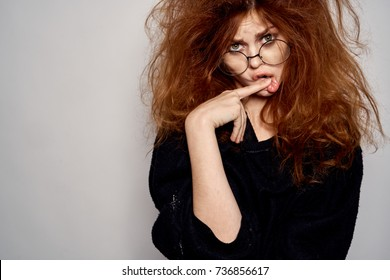 stylish woman with glasses on a light background