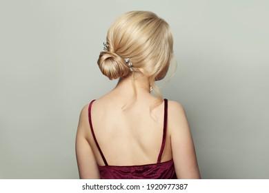 Stylish woman hairdo. Female back with blonde hairstyle on white background