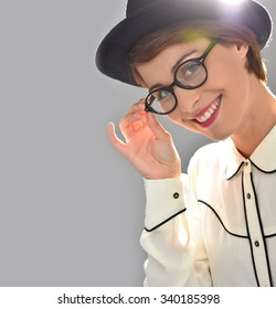 Stylish woman with hat and eyeglasses, isolated