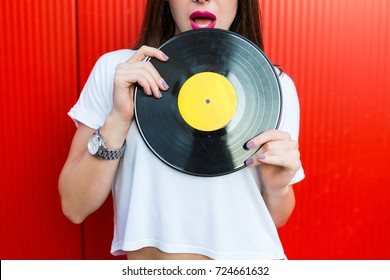 Stylish woman holding a retro vinyl record