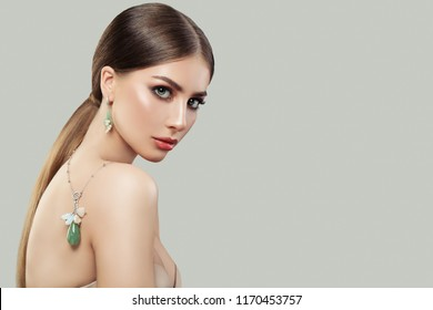 Stylish woman with jewelry portrait. Jewelry for woman, necklace and earrings with pearls. Beauty and accessories.
