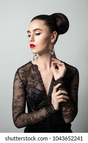 Stylish Woman with Makeup and Perfect Hairstyle