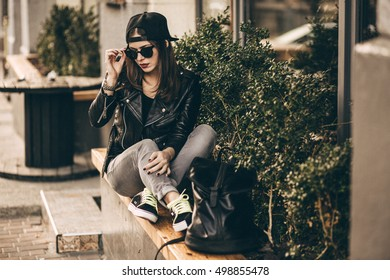 Stylish woman on a city street at summer day