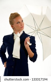 Stylish Woman in a pose with umbrella.