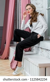 stylish woman posing in business clothes indoors