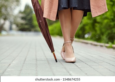 stylish woman with umbrella in a city