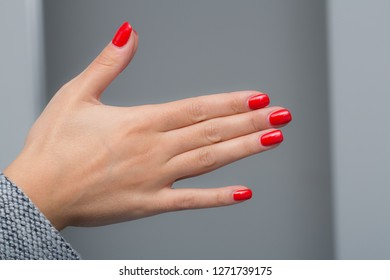 Stylish woman's hands with painted fingernails