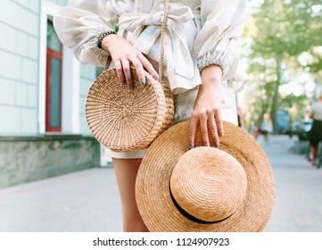 Stylish woman s outfit. Nature stylish top. Straw bag. White dress.Woman  hands 2d9d22815194b