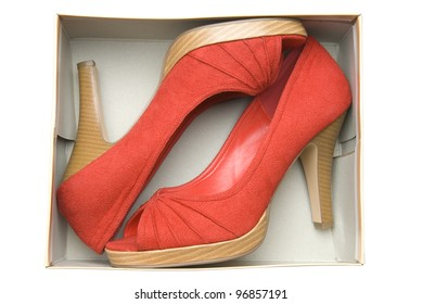Stylish woman's shoes in a box on white background