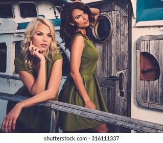 Stylish women on old rusty boat