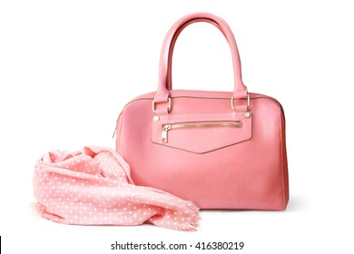 Stylish women's accessories. Beautiful set of women's handbag and scarf on a white background. Light pink, light coral