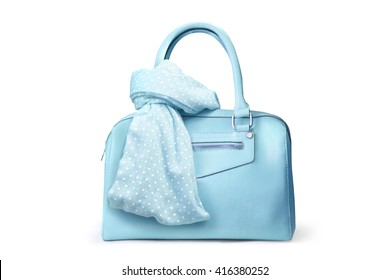 Stylish women's accessories. Beautiful set of women's handbag and scarf on a white background. Medium sky blue, pale turquoise