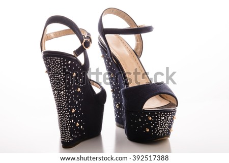 d59ecb926e Stylish women's blue sandals with high heels with studs on a white  background.