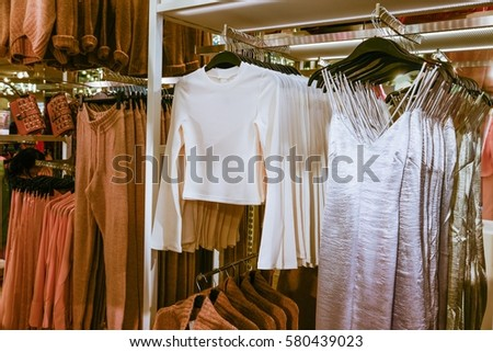 9a888a3af62 Stylish Womens White Clothes On Hangers Stock Photo (Edit Now ...