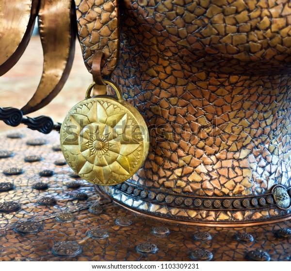 Stylish yellowish round shape metallic object isolated unique photograph