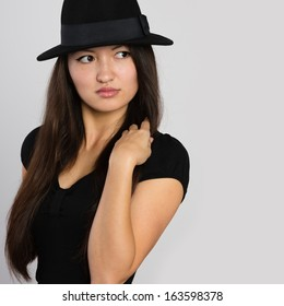 Stylish young Asian woman looks away. Mixed race Asian Caucasian girl.