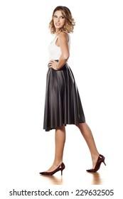 Stylish young beautiful woman in a long black skirt