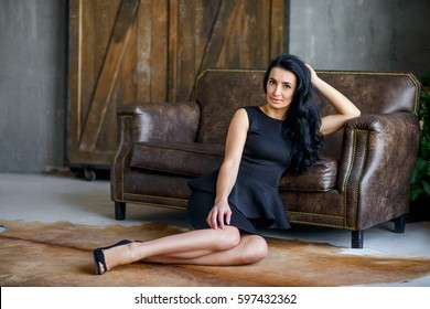 stylish young brunette with long hair