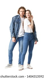 Stylish young couple in jeans clothes on white background