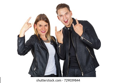 Stylish young couple wearing leather jackets showing rock and roll symbol on isolated
