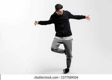 5818eb87 Stylish young dancer wearing a black sweatshirt and gray pants is dancing  hip-poh
