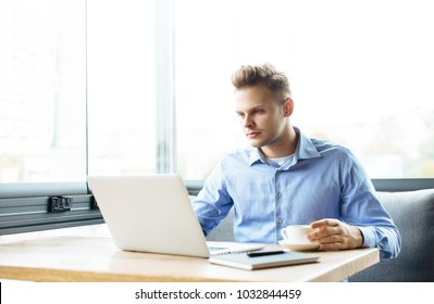 Stylish young man calling by the phone to solve business problems. Online consultation by phone. Freelancer discussing the development and planning of his online project. Outsourcing. Mobile services.