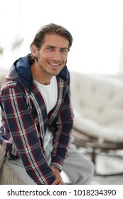 stylish young man in plaid shirt.