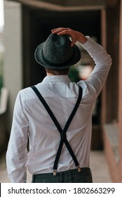 stylish young man in suspenders