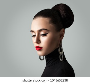Stylish Young Woman with Perfect Hairstyle and Eyeliner Makeup. Cute Female Face. Eyes Closed