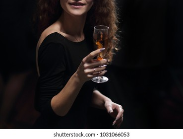 stylish young woman raising a glass of champagne
