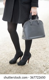 Stylish young woman wearing a black winter look is pictured during the Mercedes-Benz Fashion Week Berlin Autumn/Winter 2016 in Berlin, Germany on January 21, 2016. Detail of bag and black shoes