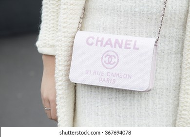 Stylish young woman wearing a winter look is pictured during the Mercedes-Benz Fashion Week Berlin Autumn/Winter 2016 at Brandenburg Gate in Berlin, Germany on January 21, 2016. Detail of the bag