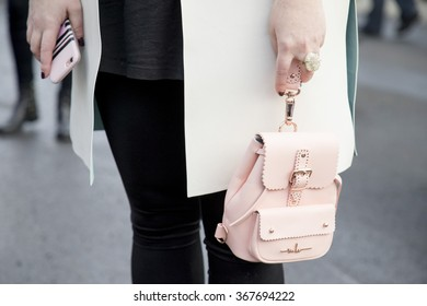 Stylish young woman wearing a winter look is pictured during the Mercedes-Benz Fashion Week Berlin Autumn/Winter 2016 at Brandenburg Gate in Berlin, Germany on January 21, 2016. Detail of the pink bag